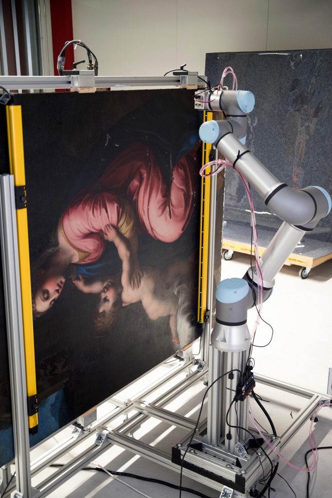Robotic X-ray Scanner With Madonna and Child Painting