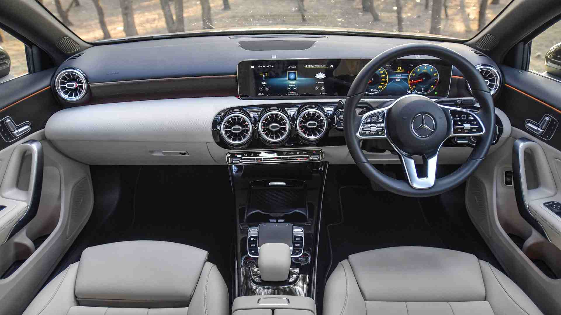 Two screens housed within a single pane of glass and turbine-style AC vents stand out on the minimalistic dash. Image: Overdrive/Anis Shaikh