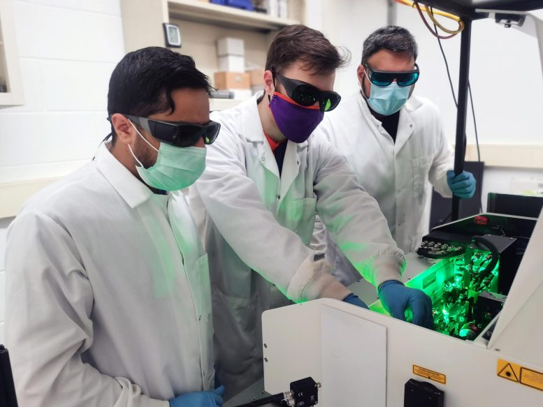 From left, Pan Adhikari, Lawrence Coleman and Kanishka Kobbekaduwa align the ultrafast laser in the Department of Physics and Astronomy's UPQD lab. Credit Clemson University