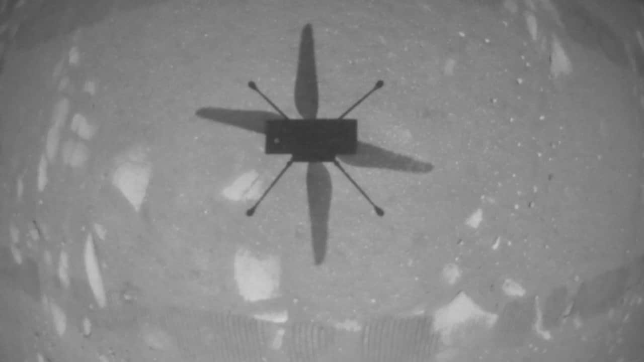 NASA's Ingenuity Mars Helicopter took this shot while hovering over the Martian surface on April 19, 2021, during the first instance of powered, controlled flight on another planet. Image credit: NASA