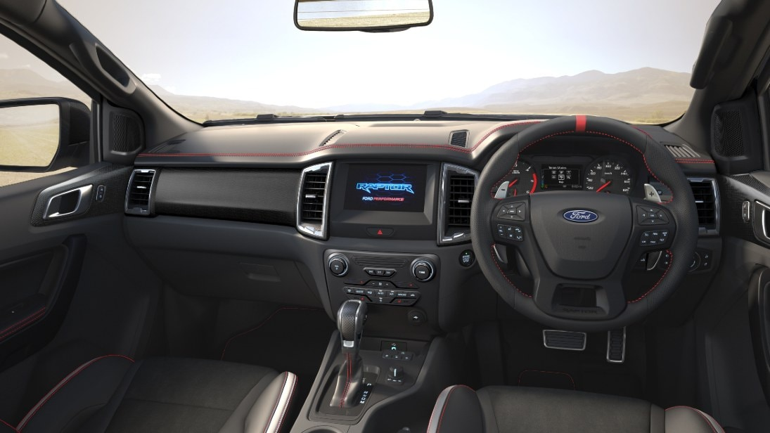 Red stitching and blacked-out elements are exclusive to the Ford Ranger Raptor X's interior. Image: Ford