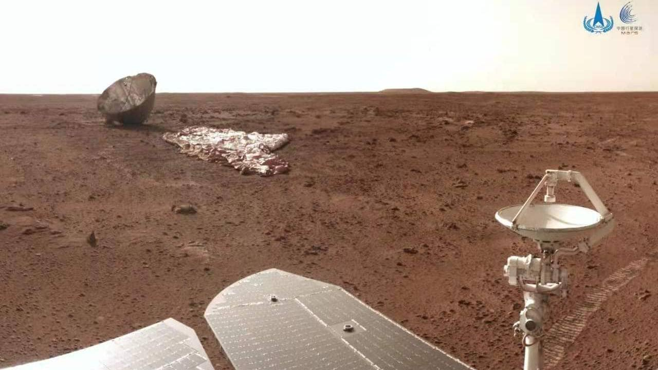 The burnt yet unbroken protective shell (far left), the deflated parachute (far right) and part of China's Mars rover. /China National Space Administration