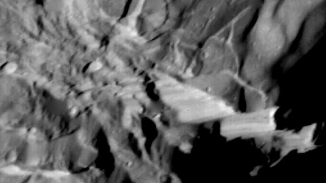 Verona Rupes, about 50km long and several km high, but not actually so cliff-like as it appears as seen by Voyager 2 during its 1986 flyby. NASA/JPL