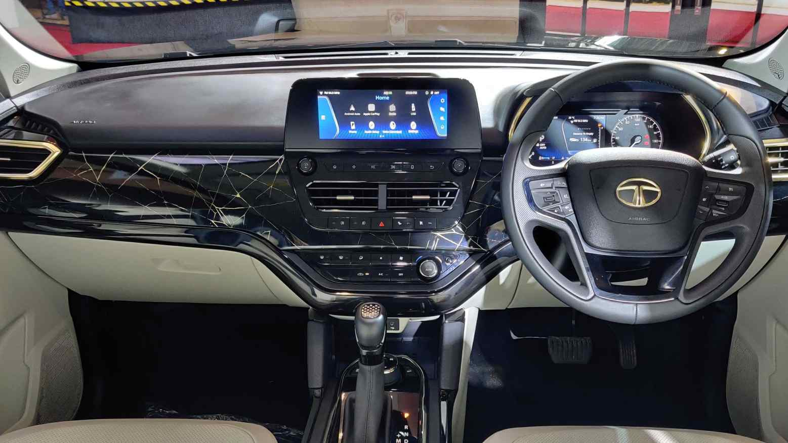 Marble-like dashboard trim accompanies more golden accents inside the Safari Gold. Image: Tech2/Amaan Ahmed